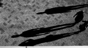 Schatten von drei Menschen
